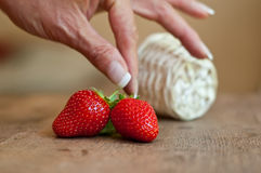 Hand of woman with strawberries Stock Photography