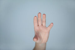 Hand of a woman touching an invisible screen Royalty Free Stock Photos