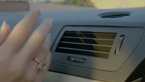 Hand of woman turning ac heat on in car  -. Hand of woman turning ac heat on in car stock video footage