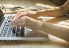 Hand woman typing on laptop on wooden desk.  Royalty Free Stock Photo