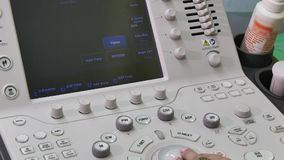 Hand of woman and ultrasound examination medical equipment. Diagnosis of person in clinic stock footage