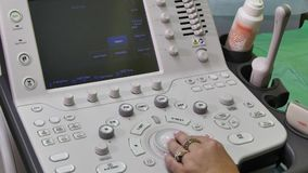 Hand of woman and ultrasound examination medical equipment. Diagnosis of person in clinic stock video footage