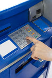 Hand of a woman using an ATM Stock Image