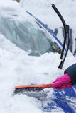 Hand of woman using brush and remove snow from car and windscreen Royalty Free Stock Photos