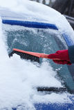 Hand of woman using brush and remove snow from car and windscreen Royalty Free Stock Photography