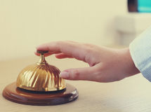 Hand of a woman using a hotel bell Stock Images