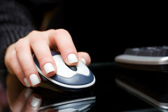 Hand of woman using mouse Stock Image