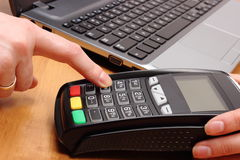 Hand of woman using payment terminal, enter personal identification number Royalty Free Stock Photos