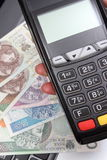 Hand of woman using payment terminal, polish currency money on laptop Stock Images