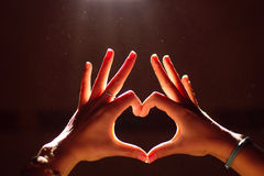 Hand of the woman who made the heart by hand Royalty Free Stock Image