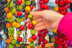 Hand of woman with wooden necklace on stall at the bazaar Stock Photos