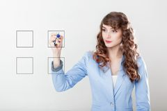 Hand of woman writing on screen. Business woman checking mark on checklist with blue marker Royalty Free Stock Images