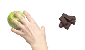 Hand women choosing apple against chocolate Stock Images