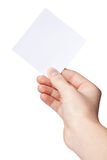 Hand of women holding blank paper label. Isolated on white Royalty Free Stock Photo