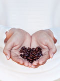 Hand of women holding coffee beans . Royalty Free Stock Image