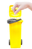 Hand women Pick catch , yellow Garbage bins isolated on white Royalty Free Stock Photography
