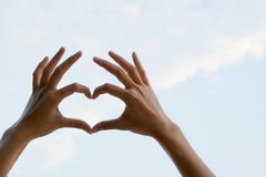 Hand of women showing heart shape. stock images