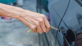 Hand of women are unlocking car doors Stock Photo