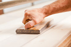 Hand wood smoothing with belt sander Stock Photos