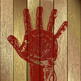 Hand on wooden planks Royalty Free Stock Photos