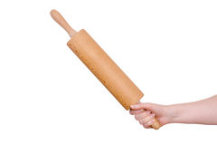 Hand with wooden rolling pin Stock Photo