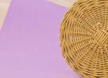 Hand wicker basket on purple background. Hand wooden wicker basket on purple background royalty free stock photo
