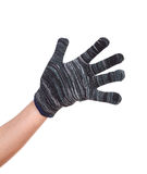Hand in a woollen glove on white background Stock Photo