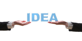 Hand and the word IDEA. Hand and the word - business concept (isolated on white background Royalty Free Stock Images
