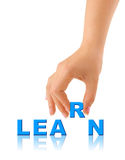 Hand and word Learn Stock Photo