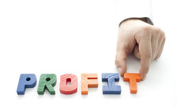 Hand and word Profit on white background Stock Photography