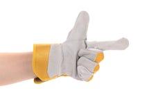 Hand in work glove like a gun. Royalty Free Stock Photo