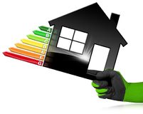 Energy Efficiency - Symbol in the Shape of House. Hand with work glove photo holding a black symbol in the shape of a house 3d illustration with energy Stock Images