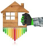 Energy Efficiency - Wooden House. Hand with work glove photo holding a wooden house 3d illustration with energy efficiency rating. Isolated on white background royalty free stock images