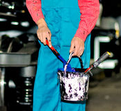 Hand of a worker in a factory. The hand of a worker using blue paint Royalty Free Stock Images