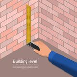The hand of the worker. Holds a construction ruler. The measuring tool in work.3D. Isometric vector illustration royalty free illustration