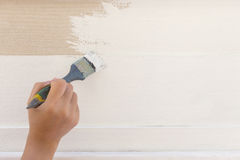 Hand worker holding brush painting white Royalty Free Stock Photo