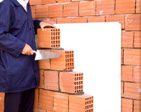 Hand of worker laying bricks Royalty Free Stock Images