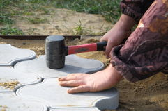 Hand of worker laying tile Royalty Free Stock Images