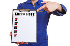 Hand of a worker showing checklist Stock Photo