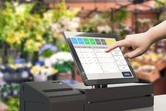Hand working cashier machine. Human hand working with 3d rendering cashier machine Stock Photos