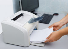 Hand with working copier Royalty Free Stock Image