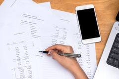 Hand working with financial statement Stock Image