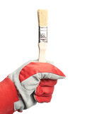 Hand in a working glove holding brush Royalty Free Stock Photography