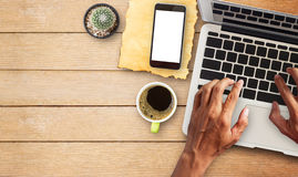 Hand working laptop comuter with cup of coffee Royalty Free Stock Photos