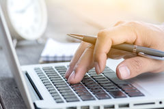 Hand working with pen and laptop Royalty Free Stock Photography