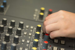 Hand working on a sound mixing desk Royalty Free Stock Photo
