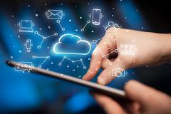 Hand working on tablet with cloud technology system concept. Hand working with cloud technology system and office symbol conceptn Royalty Free Stock Photo