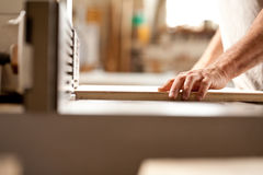 Hand working with a wood shaper Stock Photos