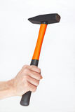 Hand of a workman holding a hammer on white background Stock Photography