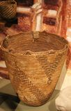 Hand woven basket with ethic design. Handwoven empty baskets made from wood, reeds, branches, leather hide, and twine. Intricate zig-zag pattern from possible Royalty Free Stock Photo